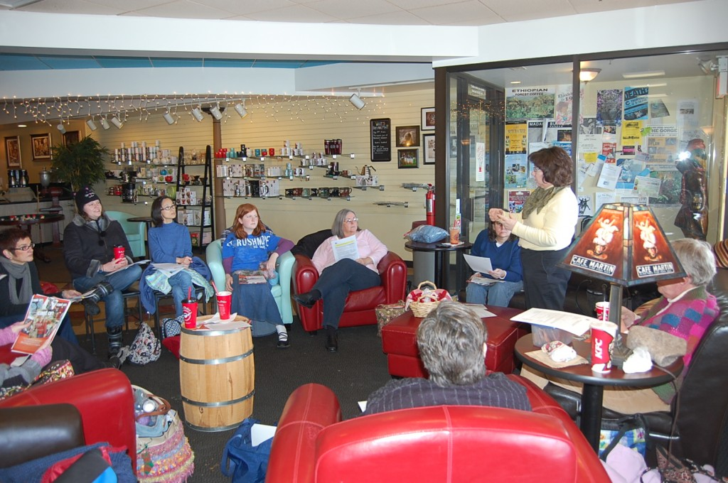 Elizabeth describes The Knitting Guild Association with knitters at Boston Stoker